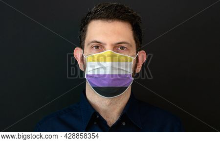 Portrait Of An Adult Man Wearing A Lgbt Non-binary Flag Colors Facial Mask. Lgbt Gay Rights Concept
