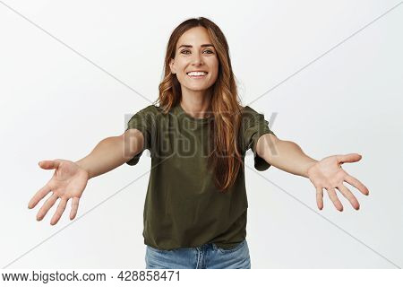 Lets Hug. Smiling Caring Adult Woman, Mother Spread Hands Sideways For Cuddles, Wants To Hold Or Emb