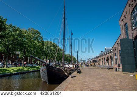 Old Sailing Boats In The Harbor Of Den Helder, The Netherlands.