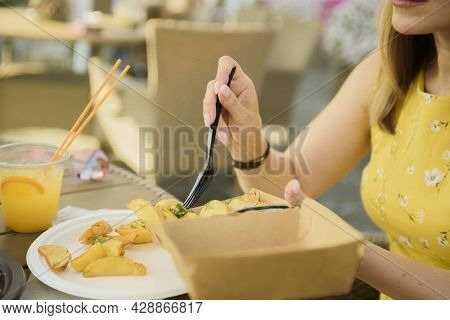 Food Using Disposable Tableware. Black Disposable Fork With A Slice Of Fried Potatoes. Summer Street