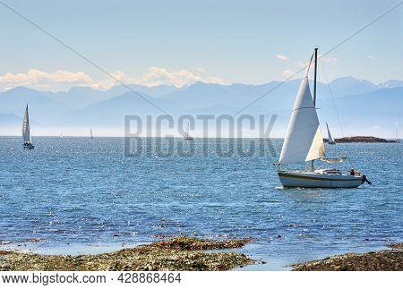 Victoria, British Columbia, Canada - July 25, 2021. Oak Harbour Sailing Victoria. Smooth Sailing Off