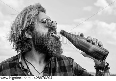 Concept Of Alcohol Drinking. Man Drink From Glass Bottle. Brutal Man With Water. Refresh With Water.