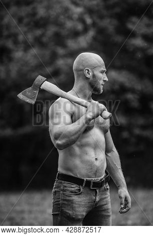 Handsome Shirtless Man Muscular Body. Bodybuilding Sport Concept. Forester With Axe. Last Man On Pla