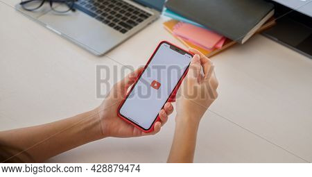 Chiang Mai, Thailand - May 23, 2021 : Hand Is Pressing The Screen Displays The Youtube App Icons On