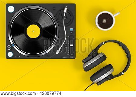 Professional Dj Turntable Vinyl Record Player With Headphones And Coffee Cup On A Yellow Background.