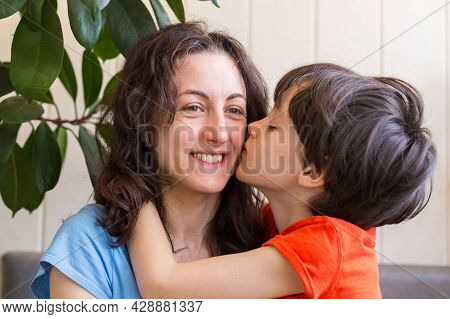 Boy Kisses Mom, Child Congratulates Mom On Mother's Day, Woman Hugs Her Son, Boy Spends Time With Mo