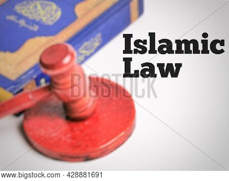 Selective Focus Phrase Islamic Law With Blurry Background. Islamic Law Concept.