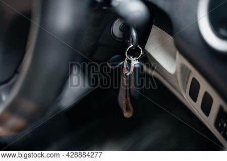 Car Key Into Ignition Lock. Close Up