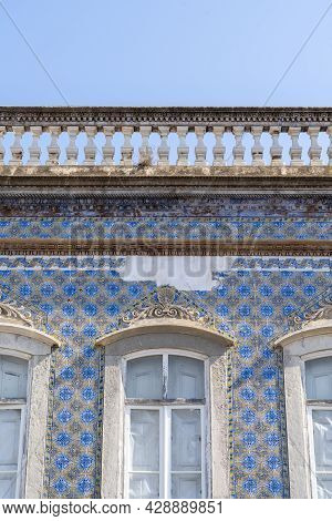 Travel To Portugal. Old Vintage Facade And Window From House Exterior In Portuguese Typical Traditio