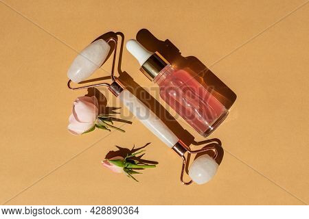 Massage Quartz Roller For The Face Of Pink Natural Nephritis With Beauty Serum Or Rose Essential Oil