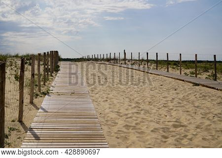Beach Access Wooden Pathway Of Atlantic Sea In Sand Dunes With Ocean In Gironde France Southwest