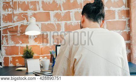 Back View Freelance Hipster Modern Asian Man Designer Working Home Using Laptop In Living Room At Ho