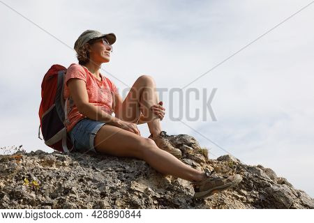Female Tourist With Backpack On Top Of A Hill In Silence And Loneliness Admires A Tranquil Natural L
