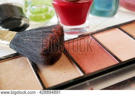 Set Of Cosmetic Makeup Products. Nail Polish, Mascara, Lipstick, Eye Shadows, Brush, Powder, Lip Glo
