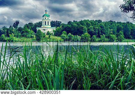 Lake And Church Bell Tower On A Cloudy Day Landscape