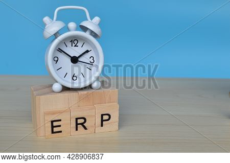 White Clock And Wooden Blocks With Text Erp Stands For Enterprise Resource Planning