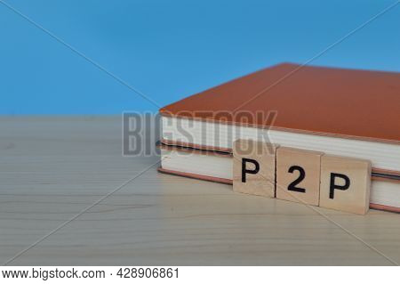 Brown Books And Wooden Blocks With Text P2p Stands For Peer-to-peer