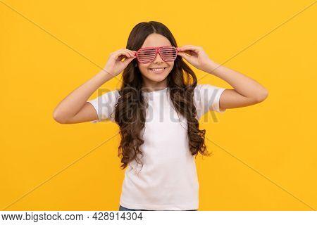 Her New Style. Happy Funny Kid In Glamour Eyeglasses With Rhinestones. Funky Teen Girl Having Fun.