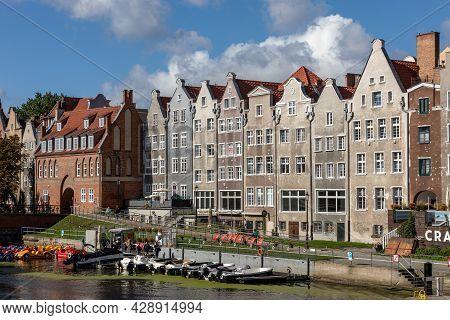 Gdansk, Poland - Sept 6, 2020: Gdansk, Old Town - Historic Tenement Houses With Gables Along Motlawa