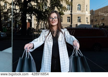 Young Woman Customer With Paper Bags. Girl Shopaholic. Black Friday, Sale, Discount.