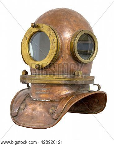 Old antique metal scuba helmet with clipping path isolated on white background. Copper old vintage deeps sea diving suit