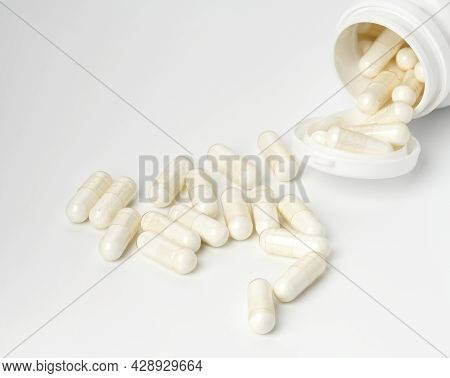 Medical Powder In White Capsules On A White Background. Treatment Pills, Nutritional Supplements. Wh