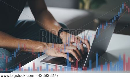 Man Stock Trading At Home Using Computer, Hands Typing On Laptop Keyboard, Double Exposure With Stoc