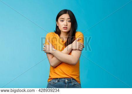 Girl Feeling Uncomfortable Walking Light Yellow T-shirt, Hugging Herself Trembling, Shaking Feeling