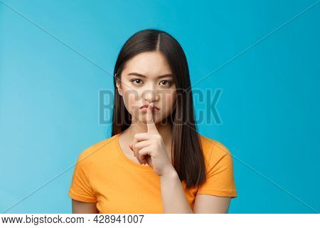 Hush Stay Silent. Serious-looking Asian Girl Look Displeased Grumpy Show Shush Sign Press Index Fing