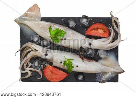 Seafood And Gourmet Food, Raw Squid With Tentacles With Tomatoes, Spices And Parsley On A Stone Plat