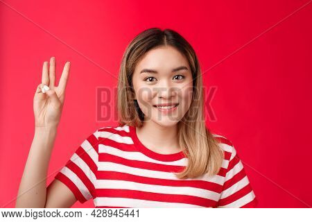 Close-up Tender Friendly Silly Young Asian Blond Girlfriend, Smiling Toothy Show Number Three Finger