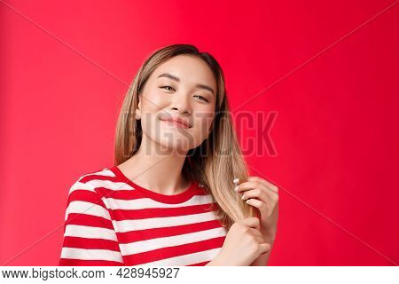 Close-up Satisfied Cute Carefree Asian Blond Girl Feeling Delighted And Pleased After Haircare Proce
