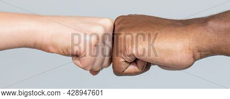 Closeup Of Multicultural Friends Giving Fist Bump To Each Other. Black African American Race Male An