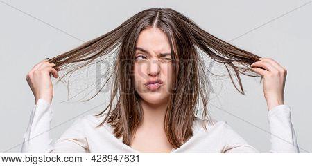 Girl Having A Bad Hair. Bad Hairs Day. Frustrated Woman Having A Bad Hair. Woman Having A Bad Hair,