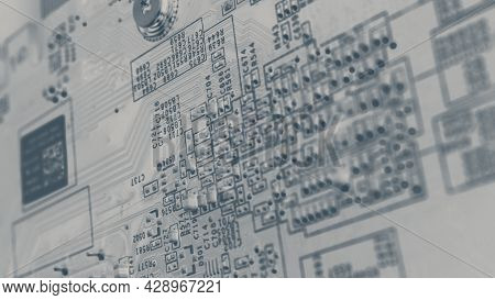 Semiconductor. Cpu Chip Located On The Green Motherboard Of The Computer.
