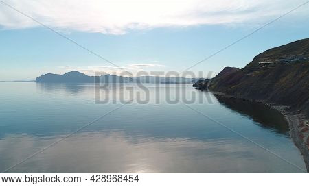 Beautiful Reflection Of Blue Sky In Mirror Water. Shot. Picturesque Seascape With Reflection Of Sky