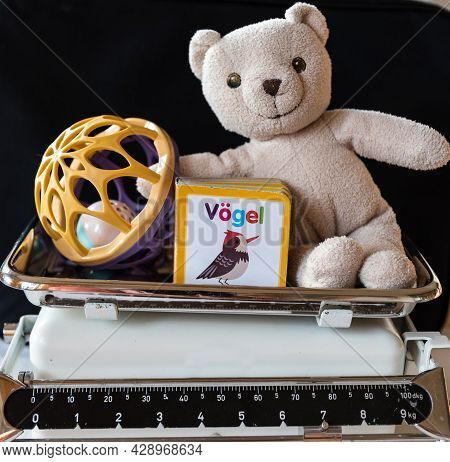 Children's Toys On Old Kitchen Scales As A Symbol Of Value And Meaning