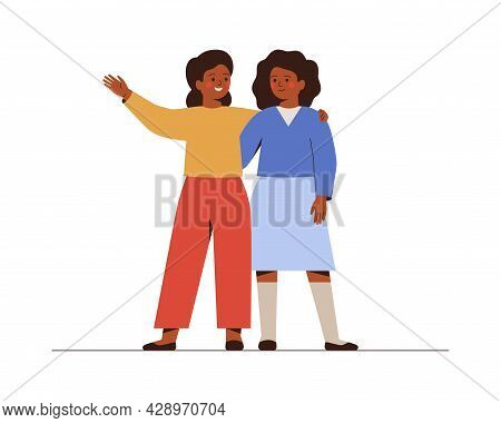 Friends Stand Together And Embrace. Smiling Two Schoolgirls Greeting And Supporting Each Other. Girl