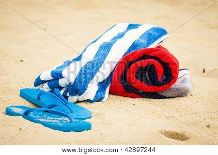 Beach Towel And Sandals On Beach