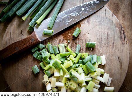 Chopped scallion on a cutting board
