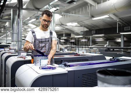 Printing Machine Operator Preparing Paint For Print Process In Printing House.