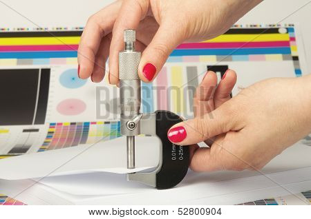Measurement of thickness of a sheet of paper by a micrometer in printing house poster