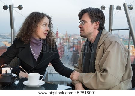 Beautiful couple in a restaurant with views of the Kremlin poster