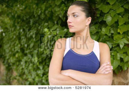Beautiful Sport Woman Portrait Over Green Leaves