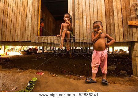 BERDUT, MALAYSIA - APR 8: Unidentified children Orang Asli in his village on Apr 8, 2013 in Berdut, Malaysia. More than 76% of all Orang Asli live below the poverty line, life expectancy-53 years old.