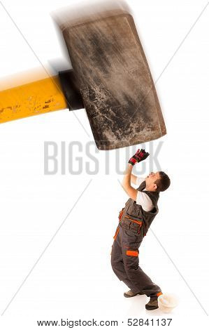 havy hammer falling on a working man poster