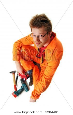 Worker In Orange Workwear With Tools