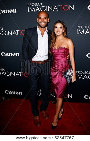 NEW YORK- OCT 24: Actor Amaury Nolasco (L) and Eva Longoria attend the global premiere of Canon's
