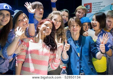 MOSCOW - MAR 30: Dutch singer, winner of the Junior Song Contest Eurovision 2009 Ralf Mackenbach with ten fans teenagers in Moscow Hall Club on Mart 30, 2013 in Moscow, Russia.