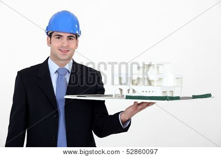 Architect with model in hand